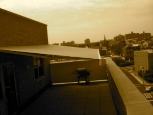 Sepia shot of k300 into brick building high up in Brooklyn