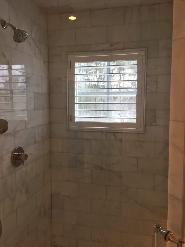 Hunter-Douglas-Palm-Beach-Shutters-Window-Shower-by-Breslow-Home-Design-Center