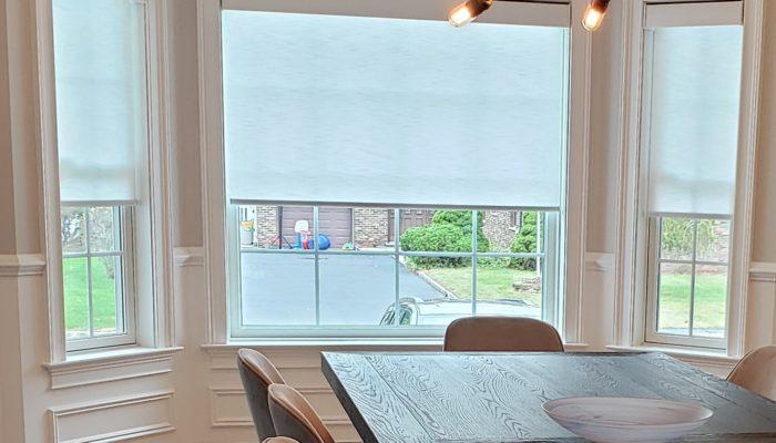 Designer Roller Shades in Dining Room - Breslow Home Design Center