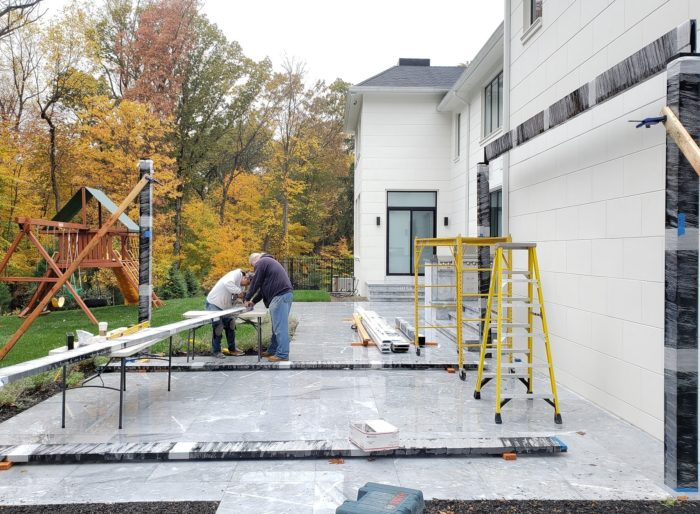 Apollo Louvered Roof Installation - Carefully cutting our next beam - Breslow Home Design Center