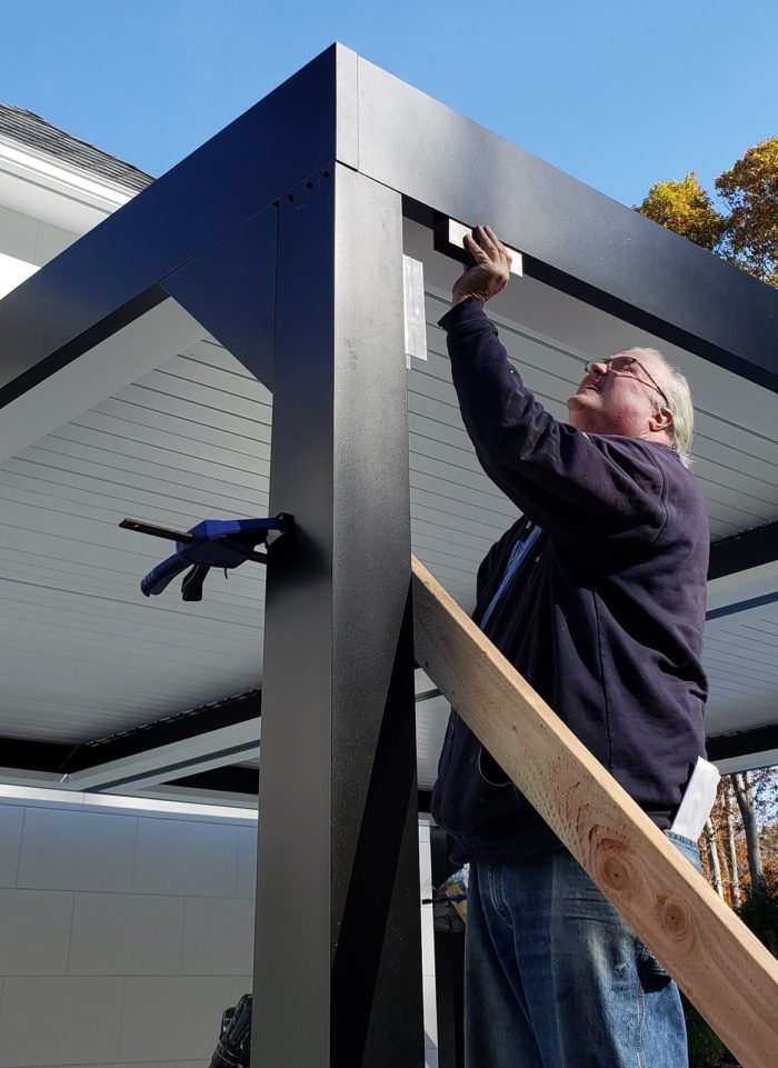 Apollo Louvered Roof Installation - Installing gussets for extra strength - Breslow Home Design Center