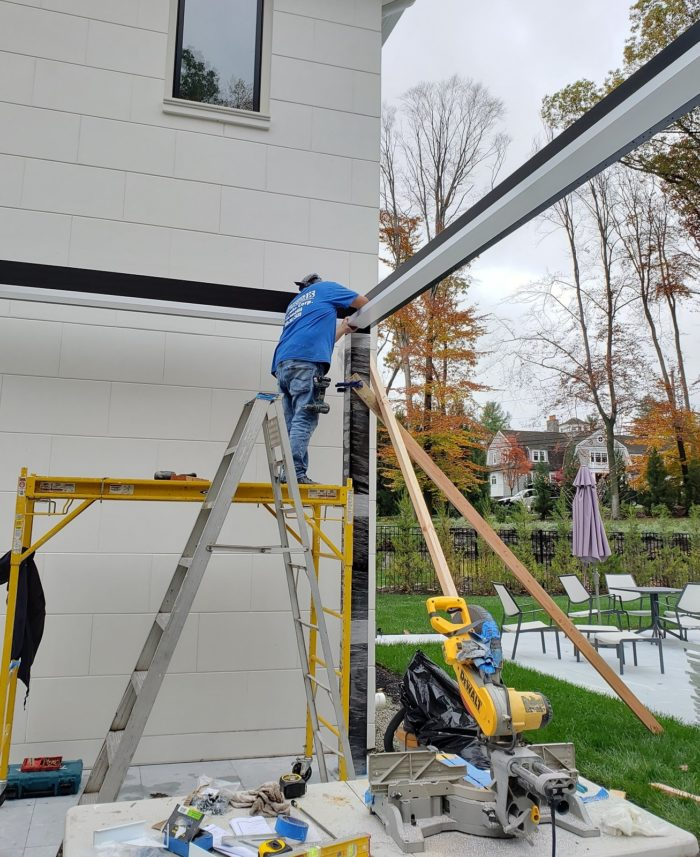 Apollo Louvered Roof Installation - Installing the two-tone white internal gutter system - Breslow Home Design Center