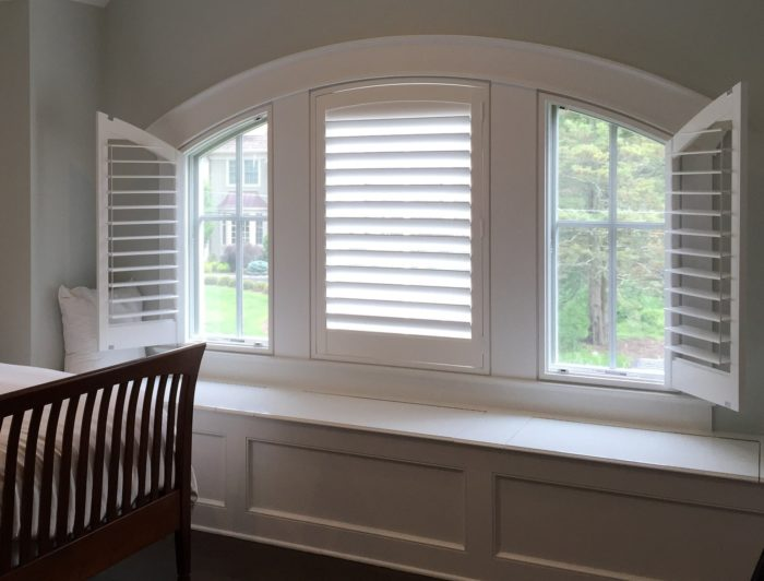 Hunter Douglas Specialty Shutters in Bedroom - Panels Open - Breslow Home Design Center