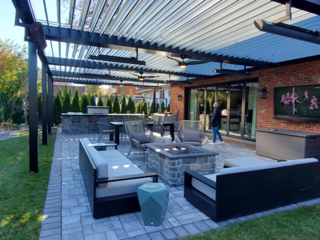 Large Apollo Roof allows the client to dine with family, chill by the fire pit, grill for guests all while staying warm, dry and cool!