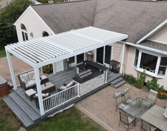 Apollo Louvered Roof Installed Over Outdoor Kitchen and Seating Area - Breslow Home Design Center