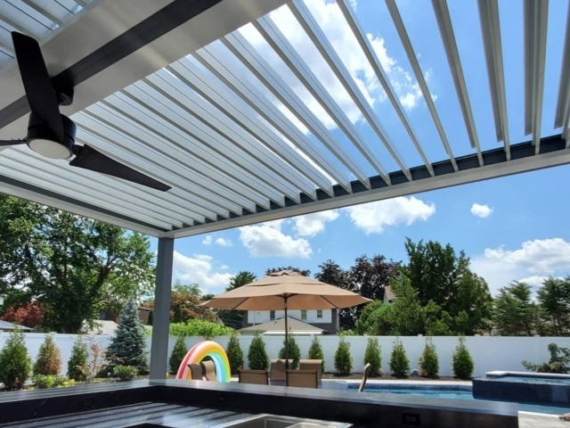 Apollo Louvered Roof System Installed Over Outdoor Kitchen - Breslow Home Design Center