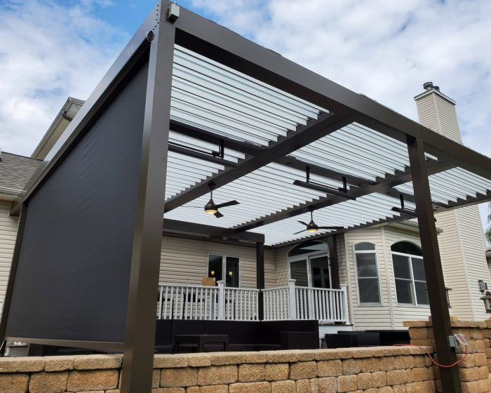 Apollo Louvered Roof System with Screen Shade Installed Over Patio - Breslow Home Design Center