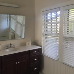 white wood blinds by Breslow Home Design