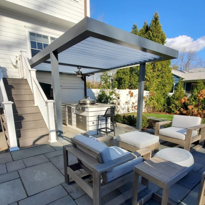 apollo louvered roof covering outdoor kitchen by Breslow Home Design