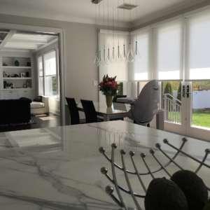 Hunter Douglas Designer rollers installed by Breslow home design